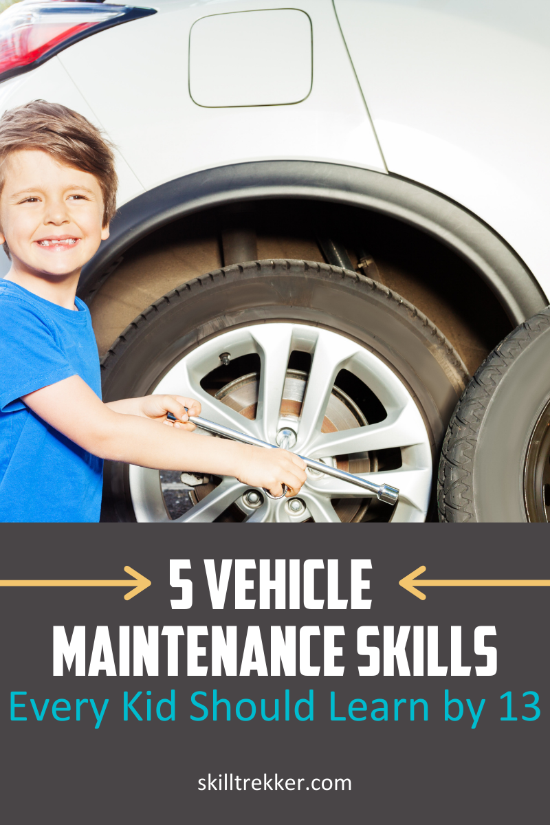 Young boy learning how to change a tire.